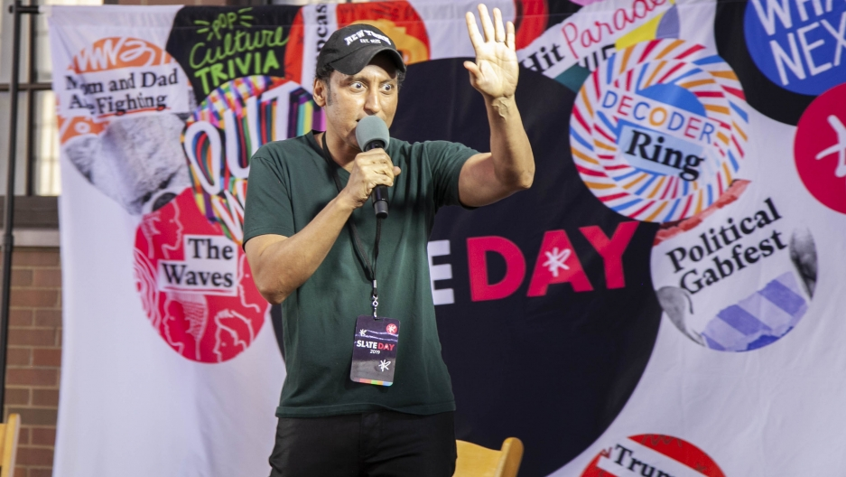 Aasif Mandvi performs stand-up during the Studio 360 live show on June 8.