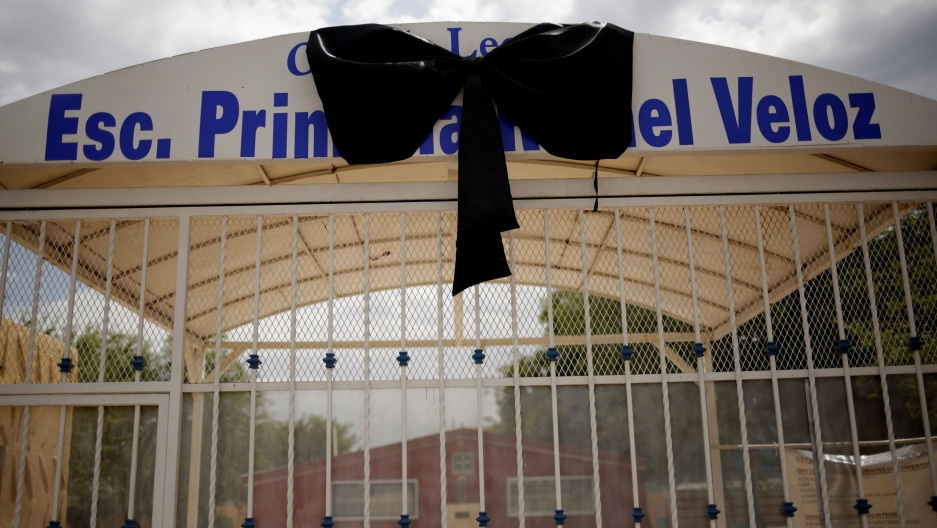 A big black ribbon adorns the gate of the RafaelVelozelementary school in Ciudad Juárez, Mexico.