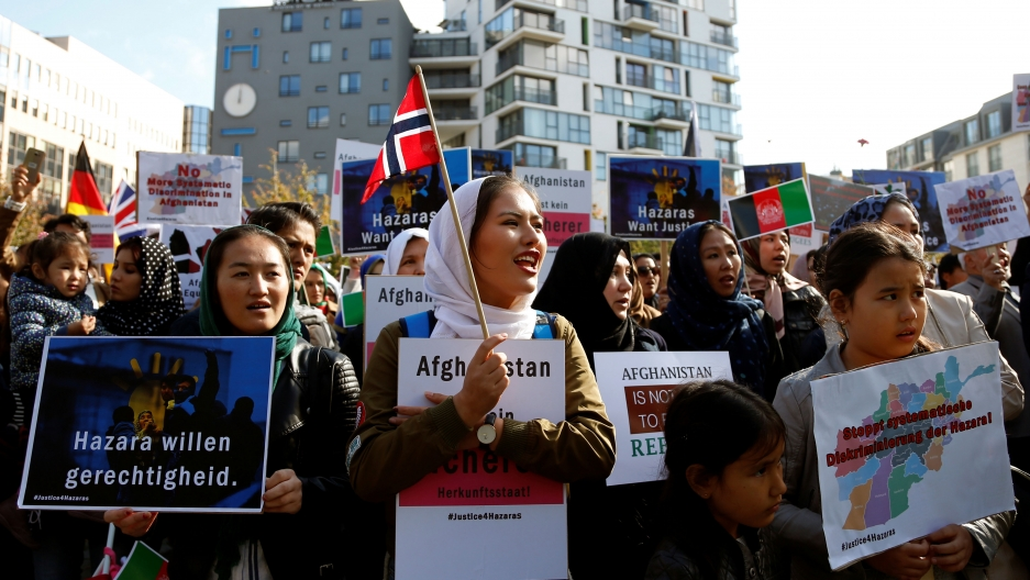 Demonstrators hold placards and attend a rally outside the Brussels Conference on Afghanistan, in Belgium, October 5, 2016.