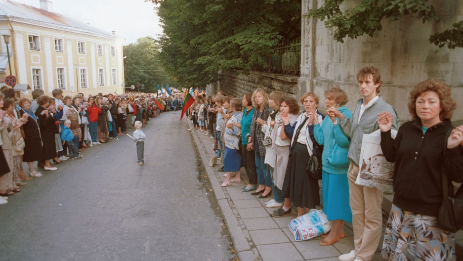 Thousands of people make a human chain from Pikk Hermann in Tallinn, Estonia, to Gediminas' Tower in Vilnius, Lithuania, on Aug. 23 in 1989.