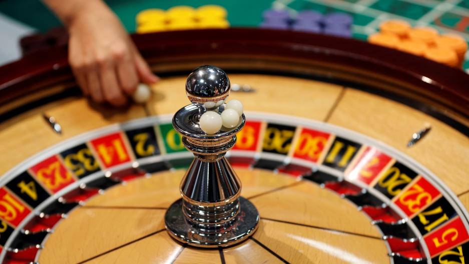A roulette wheel is spun.