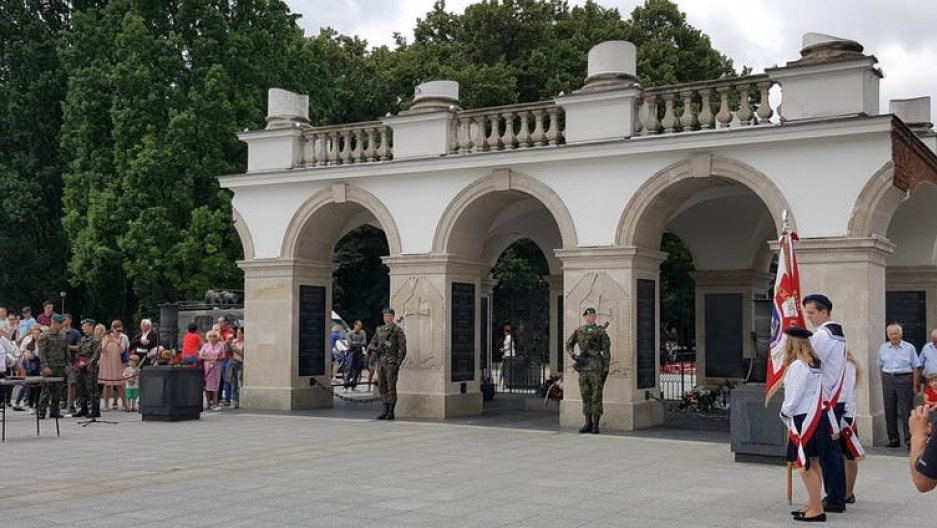 Soldiers guarding a tomb outside in Poland.