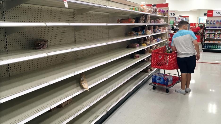 An empty shelf in a grocery store.