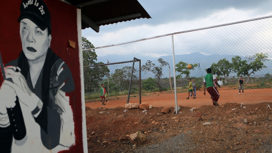 Former rebels of the Revolutionary Armed Forces of Colombia play football at a camp