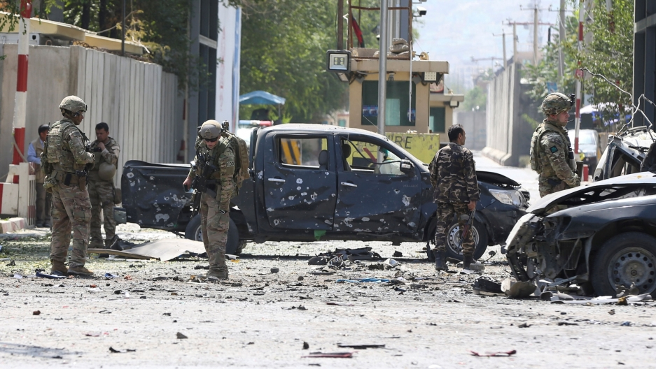 Foreign troops with NATO-led Resolute Support Mission investigate at the site of a suicide attack in Kabul, Afghanistan, on Sept. 5, 2019.