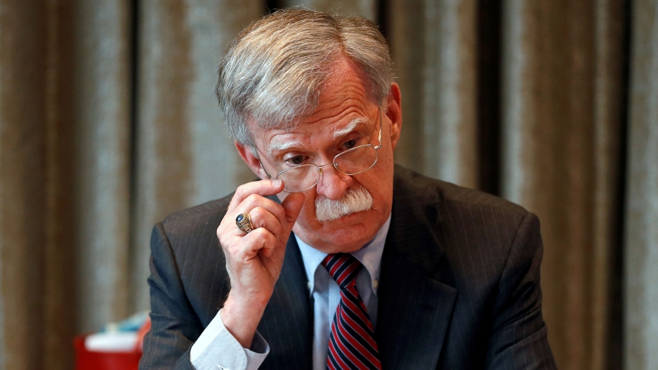 John Bolton adjusts his glasses in a file photo