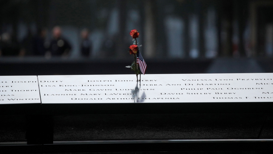 A flower sits atop the engraved names on a section of the 9/11 memorial in New York City