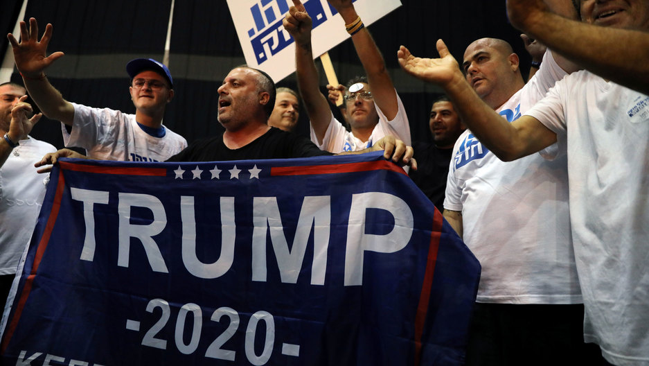 "Supporters of Israeli Prime Minister Benjamin Netanyahu's Likud party react to exit polls in Israel's parliamentary election at the party headquarters in Tel Aviv, Israel, on Sept. 17, 2019.  One sign says ""Trump 2020"" as well."