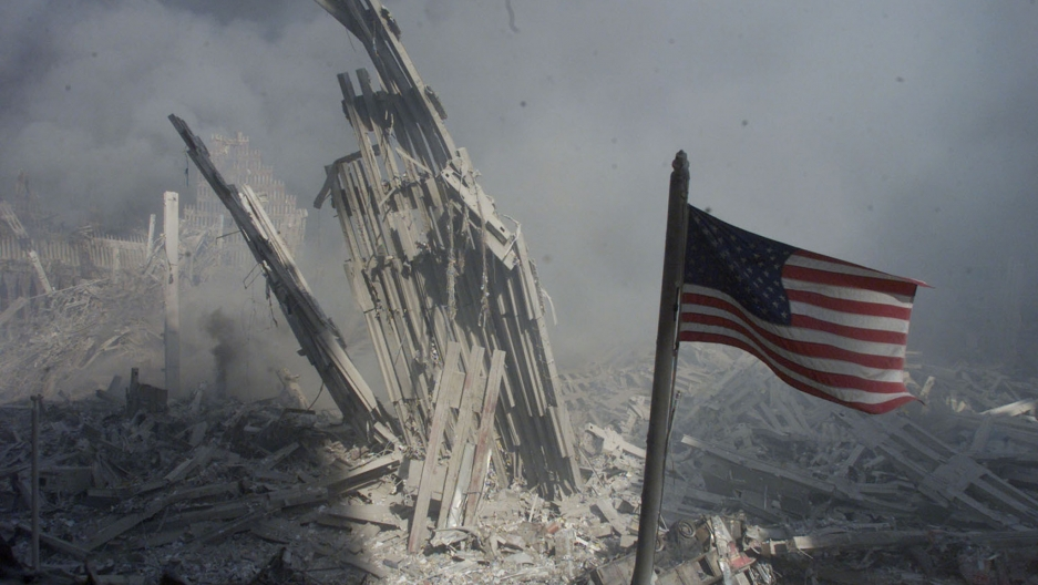 Rubble is highlighted and an American flag is in the foreground