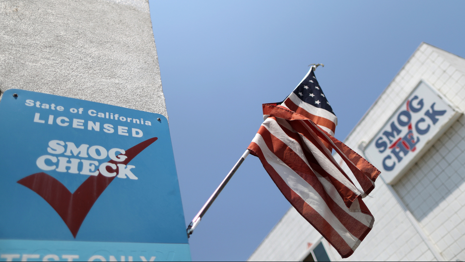 A California car smog check center is seen in Los Angeles with an American flag