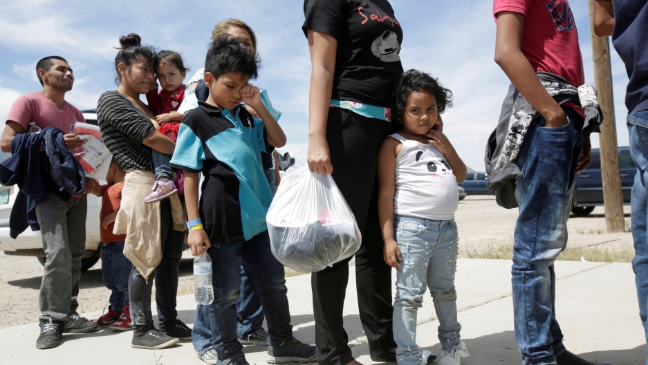 Central American migrants stand in line before entering a temporary shelter, after illegally crossing the border between Mexico and the U.S., in Deming, New Mexico, on May 16, 2019.
