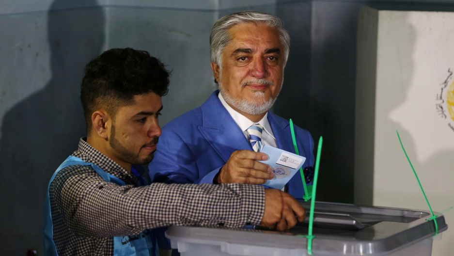 Afghanpresidential candidate Abdullah Abdullah casts his vote at a polling station in Kabul,Afghanistan.