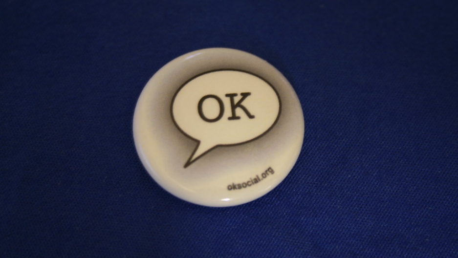 "a button with the word ""OK"""