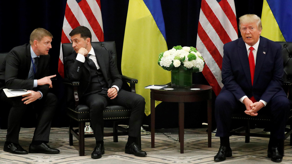 Ukraine's President Volodymyr Zelenskiy listens to a translator as he and US President Donald Trump hold a bilateral meeting