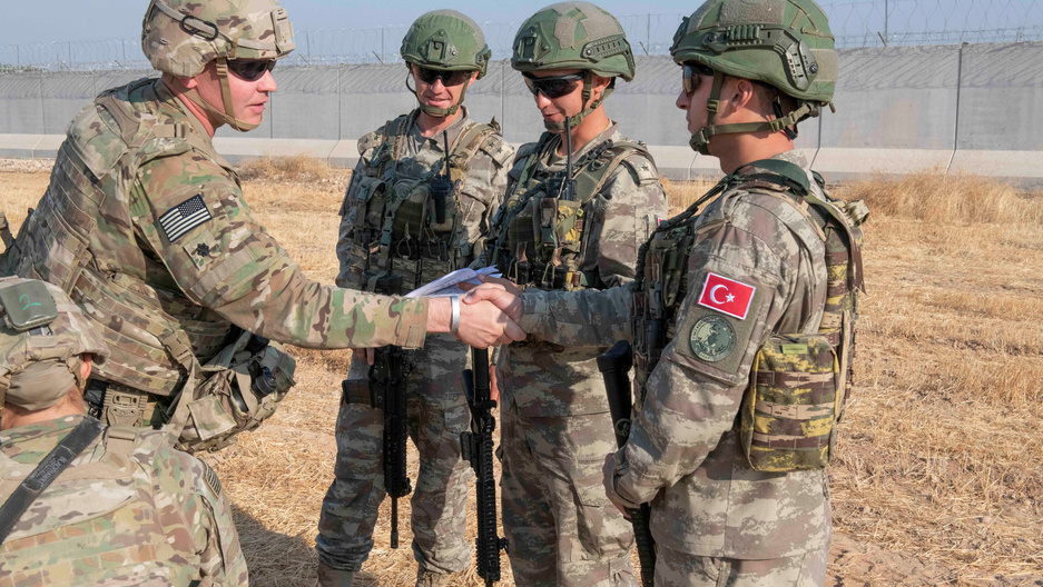 US and Turkish military forces conduct a joint ground patrol inside the security mechanism area in northeast, Syria, October 4, 2019.