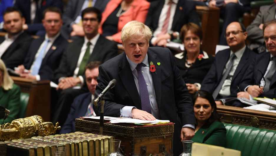 Britain's Prime Minister Boris Johnson is shown at a podium speaking with his right hand resting on the podium.