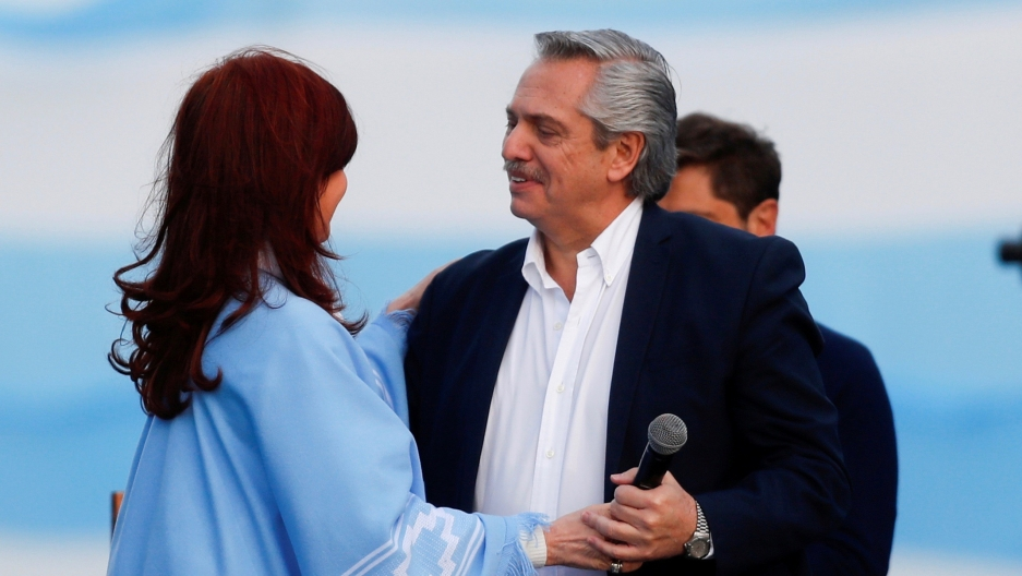 Argentina's presidential candidate Alberto Fernández and his running mate former President Cristina Kirchner embrace each other during a closing campaign rally in Mar del Plata, Argentina, Oct. 24, 2019.