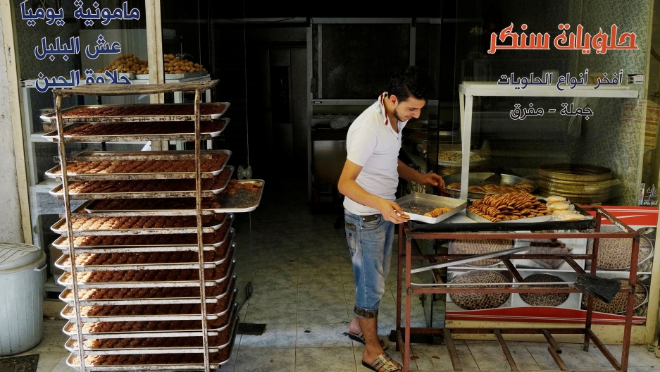A Syrian refugee man works at a bakery in Gaziantep, Turkey, May 16, 2016.