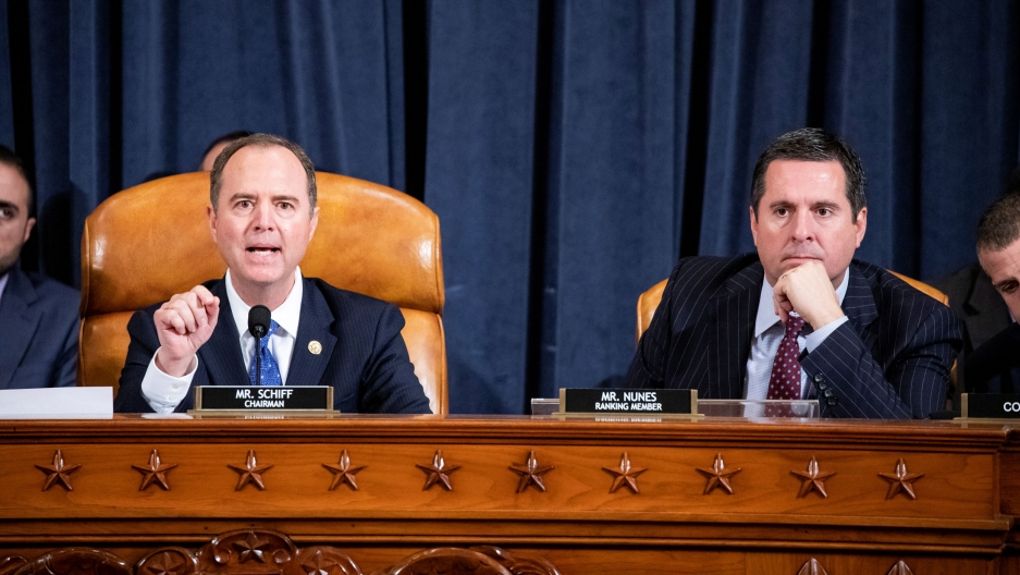House Intelligence Committee Chairman Adam Schiff (D-CA) gives his closing remarks while House Intelligence Committee Ranking Member Devin Nunes (R-CA) listens.