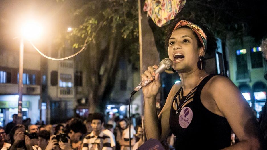 Marielle Franco speaks on a mic