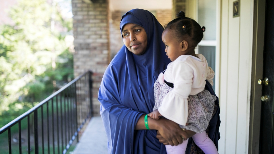 Ramlo Ali Noor, whose immediate family is affected by the Trump administration's cap on refugee numbers, poses at her apartment with her daughter Sumayo in Columbus, Ohio, on Sept. 27, 2019.