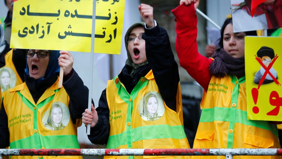 People attend a protest organized by National Council of Resistance of Iran in Germany to support nationwide demonstrations in Iran against the rise in gasoline prices, in Berlin, Germany.