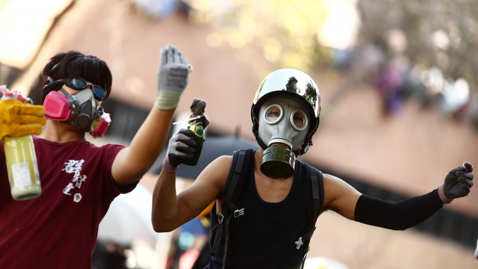 Protesters in Hong Kong wearing gas masks.