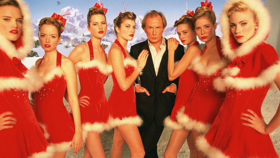 """Bill Nighy as Billy Mack with Video Vixens in """"Love Actually."""""""