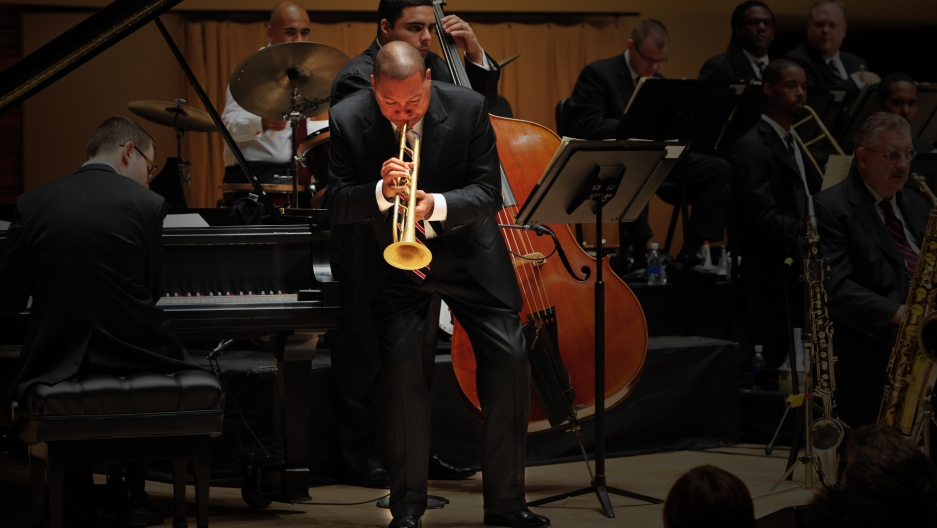 Wynton Marsalis performs on stage.