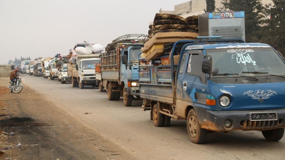 Trucks carry belongings of people fleeing from Maarat al-Numan, in northern Idlib, Syria, on Dec. 24, 2019.