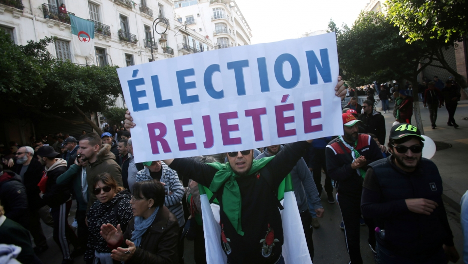 Demonstrators shout slogans during a protest to reject the presidential election in Algiers, Algeria, Dec. 12, 2019.