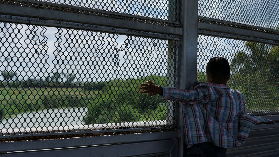A young asylum seeker looks at the Rio Grande in Matamoros, Mexico.