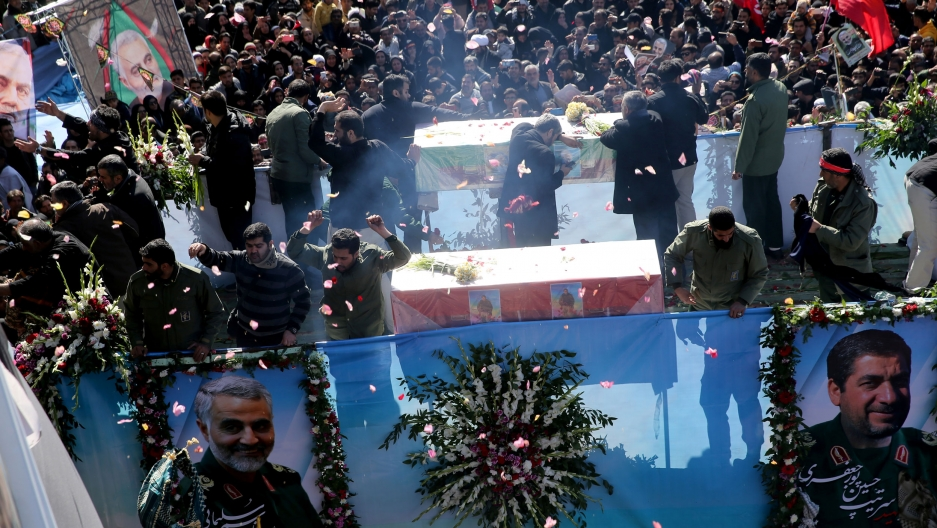Iranian people attend a funeral procession and burial for Iranian Major-General Qasem Soleimani, head of the elite Quds Force, who was killed in an airstrike at Baghdad airport, at his hometown in Kerman, Iran, Jan. 7, 2020.
