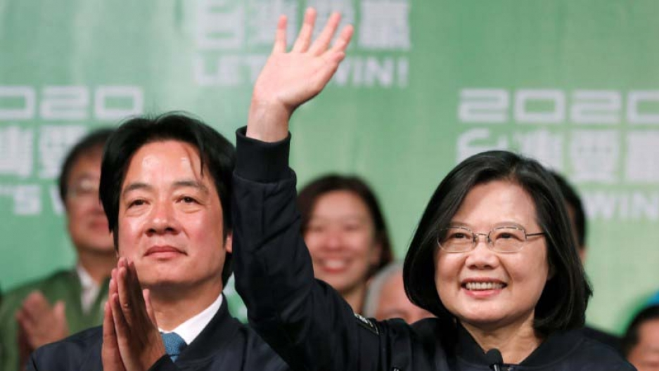 Incumbent Taiwan President Tsai Ing-wen, right, and Vice President-elect William Lai wave to their supporters after their election victory at a rally, outside the Democratic Progressive Party (DPP) headquarters in Taipei, Taiwan, on January 11, 2020.