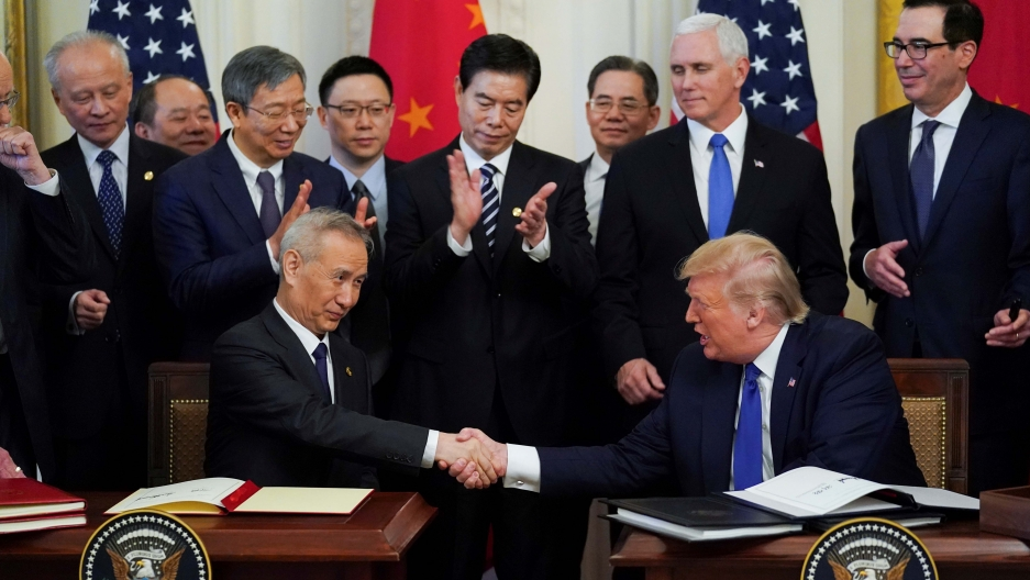 Chinese Vice Premier Liu He and US President Donald Trump shake hands after signing phase one of the US-China trade agreement during a ceremony in the East Room of the White House in Washington, DC, on January 15, 2020.