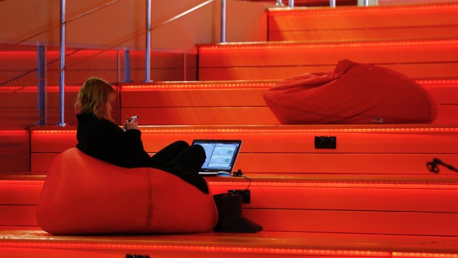 A woman with a laptop is seen in Hi-TechPark Belarus building in Minsk, Belarus, March 17, 2016.