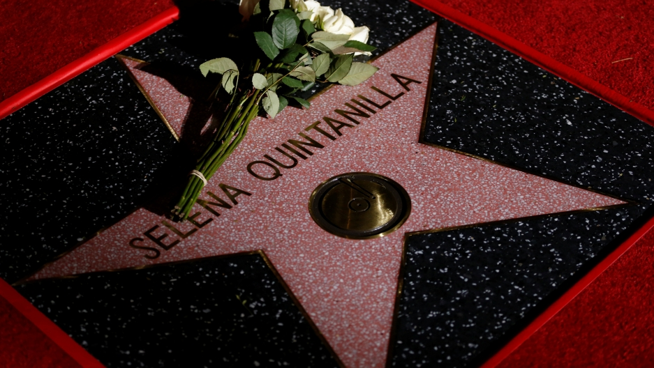 Flowers are seen on the star of late singer Selena Quintanilla-Perez after it was unveiled on the Hollywood Walk of Fame in Los Angeles, California, on November 3, 2017.