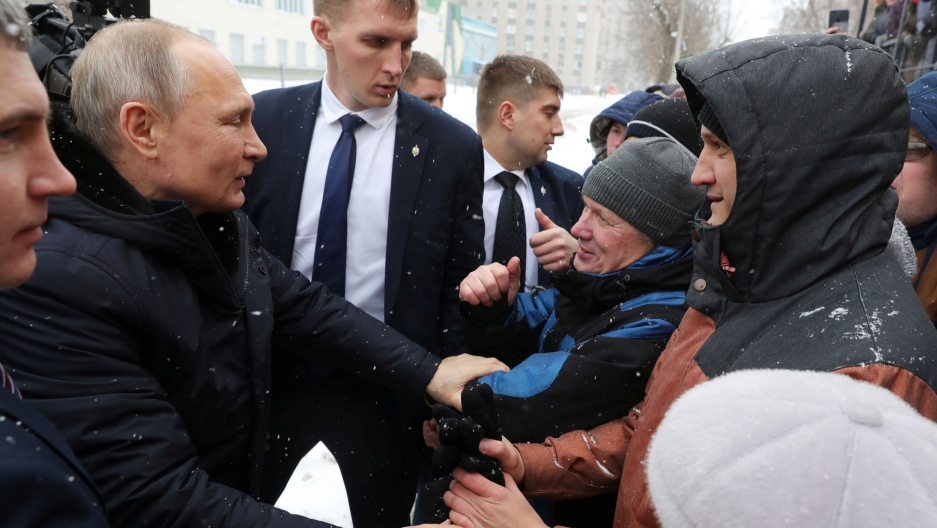 Russian President Vladimir Putin greets local residents before visiting a college of chemical technology in Cherepovets, Russia, Feb. 4, 2020.