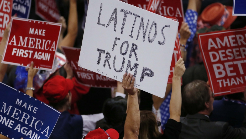 A person holds a sign reading 'Latinos for Trump' on the third day of the Republican National Convention in Cleveland, Ohio, U.S. July 20, 2016.