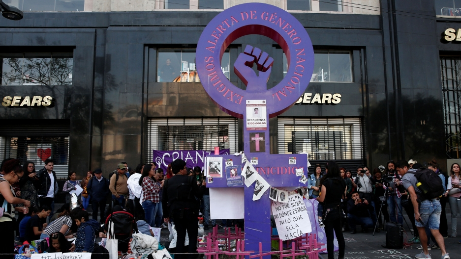 People gather in a memory of seven-year-old Fatima Cecilia Aldrighett, who went missing and whose body was discovered inside a plastic bag, at an anti-femicide monument, in Mexico City, Mexico, Feb. 19, 2020.