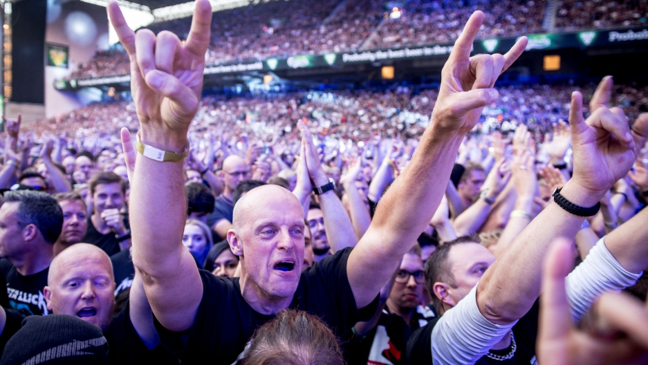 a crowd at a Metallica concert in Denmark.