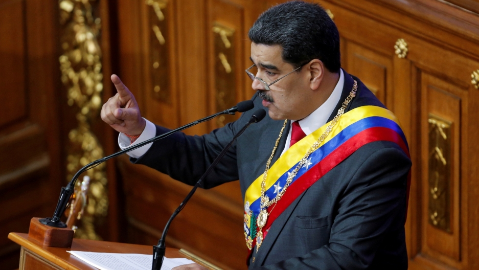 Venezuela's disputed President Nicolas Maduro gestures as he speaks during a special session of the National Constituent Assembly to deliver his annual state of the nation speech, in Caracas, Venezuela, Jan. 14, 2020.
