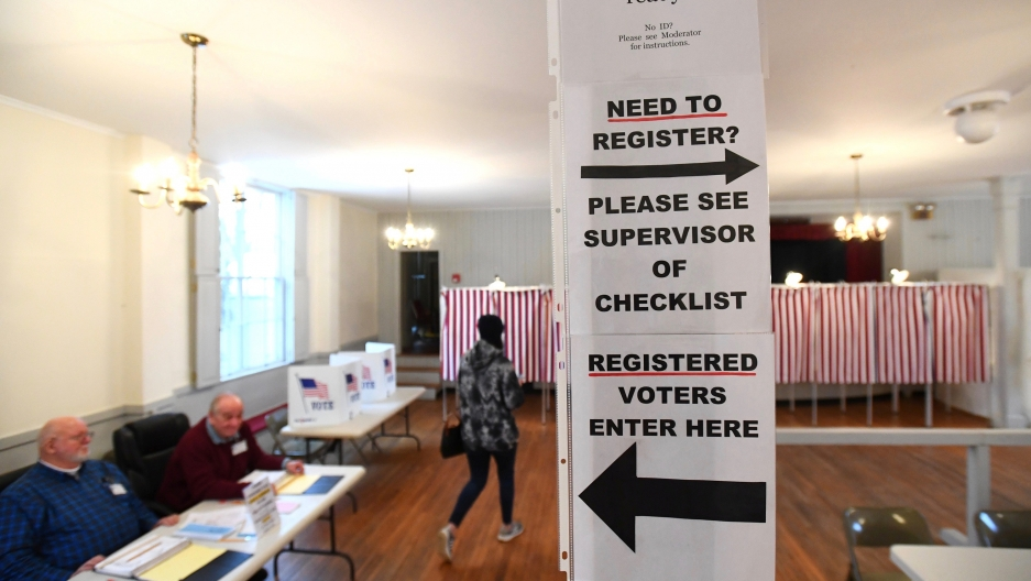 Signs direct voters at a polling place in the state's presidential primary election in Greenfield, New Hampshire, Feb. 11, 2020.