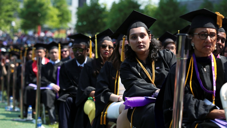 Graduates of The City College of New York sit in their seats at their commencement ceremony in Manhattan on May 31, 2019.