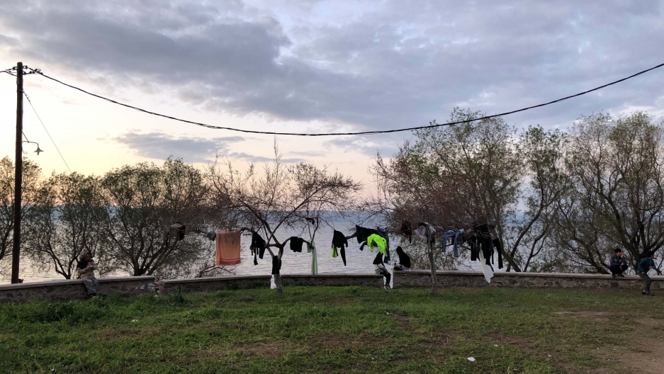 Asylum-seekers' clothes hang to dry near a makeshift camp for refugees on the Greek island of Lesbos.