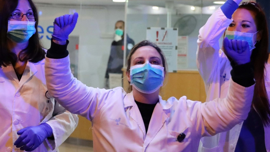 Health workers applaud people who show them gratitude from their balconies and windows as part of an event organized through social media, during a partial lockdown as part of a 15-day state of emergency to combat the spread of coronavirus disease.