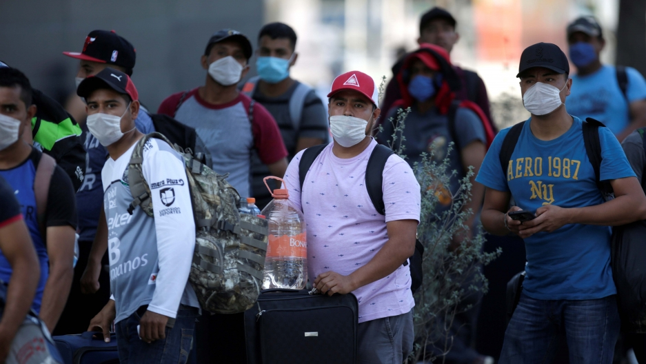 Migrants seeking for a U.S. work visa are pictured after being evicted from their hotel, which local authorities said was crowded, as part of the measures to prevent the spreading of the coronavirus disease (COVID-19), in Monterrey, Mexico March 24, 2020.