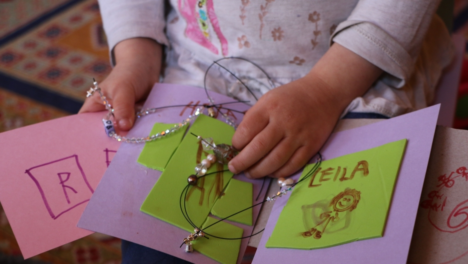 "The author's 3-year-old daughter Leila has been occupying herself during the ""stay at home"" order in Boston amid the coronavirus outbreak by making cards and beaded necklaces for her preschool friends."