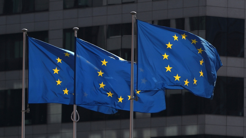 European Union flags fly outside the European Commission headquarters in Brussels, Belgium