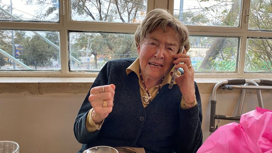 An older woman speaks on the phone